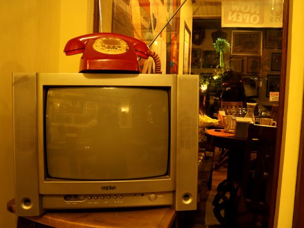 An old telephone and a not-so-old CRT TV set.