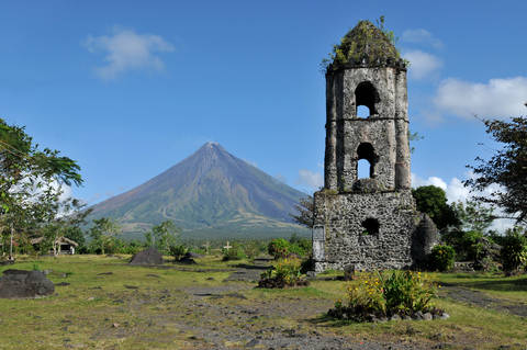 Mount Mayon Volcano and the ruins of Cagsaua Church in Albay, Bicol, Philippines.