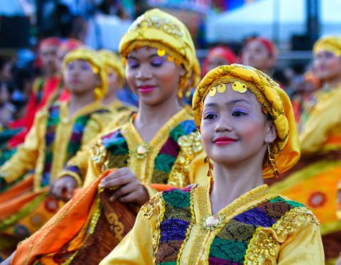 Colorfully dressed dancers at the Aliwan Fiesta in Manila, Philippines