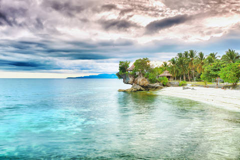 White sand beach and coconut trees in Bohol.