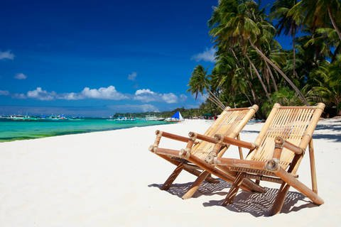 Two chairs on Boracay Island White Sand Beach in the Philippines
