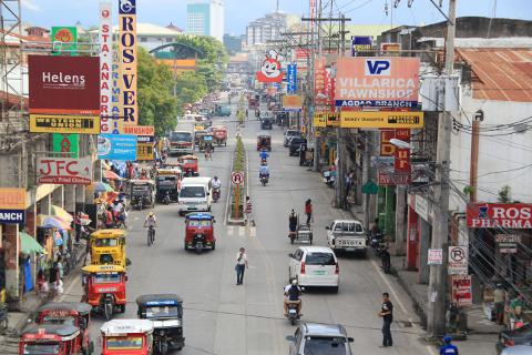 Busy traffic on downtown street in Davao City, Philippines