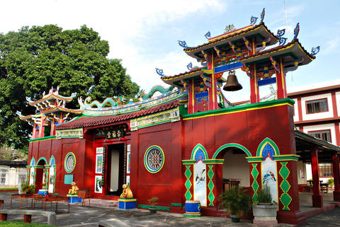 Bright red Chinese temple located in Chinatown, Manila, Philippines.