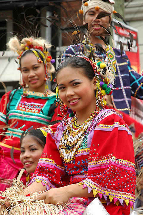 Groups in colorful traditional costumes at the Araw ng Dabaw Festival in Davao.