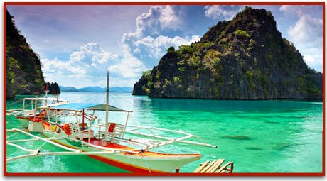 Colorful boat floating on green-blue waters at Coron Island in Northern Palawan.