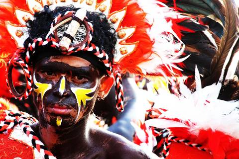 Filipino in traditional warrior dress at Dinagyang Festival in Iloilo City, Philippines.