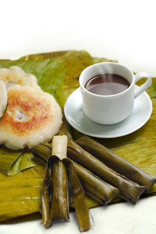 Traditional foods from the Philippines such as budbud and bibingka served with coffee.