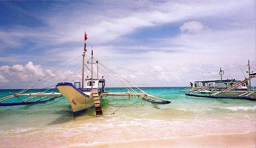 Fishing Boats on beach in Zambales, Philippines.