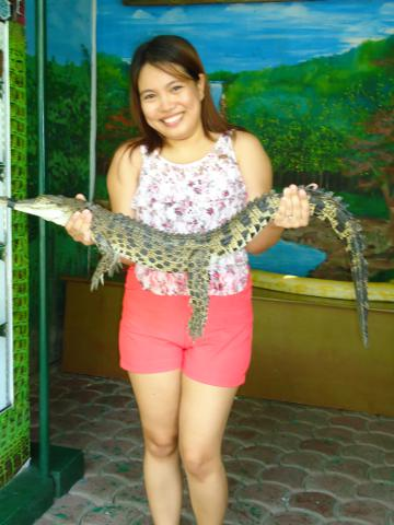 Holding a baby croc in Davao Philippines.