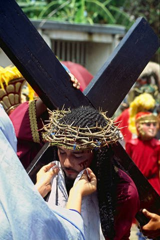 Blood being wipedfrom the face of Jesus at the Mariones Festival in Marinduque.
