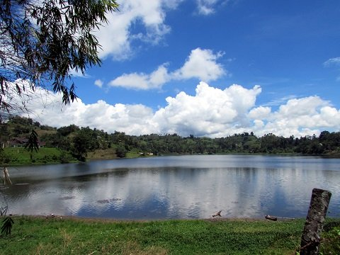 The serene Lake Sebu reflecting the sky.