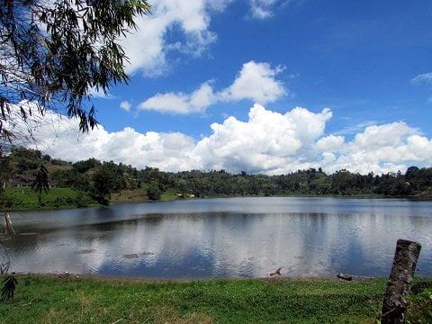 The serene Lake Sebu reflecting the sky.