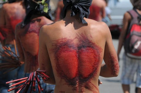 Bloody backs of the magdarame after flogging themselves during Holy Week in the Philippines.
