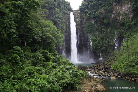 Spectacular view of Maria Cristina waterfall and lush green vegetation near Iligan City.