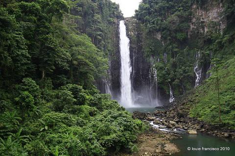 Spectacular view of Maria Cristina waterfall and lush green vegetation near Iligan City.