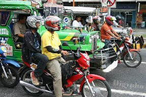 Motorcycles at traffic light in Davao Philippines.