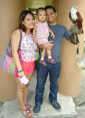 Family photo with Brahminy Kite at the entrance of the crocodile park in Davao City, Philippines.