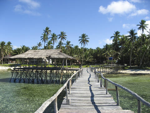 Wooden walkway over the reef at Siargao Island Philippines