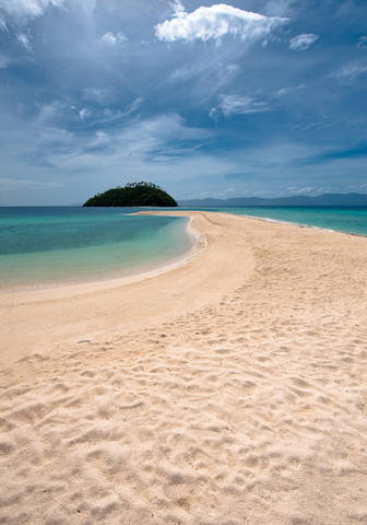 Long stretch of deserted beach in Romblon, Philippines.