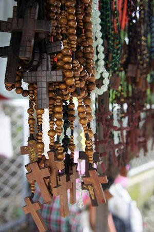 Rosary beads at stand in Philippines are a reflection of Catholic influence.