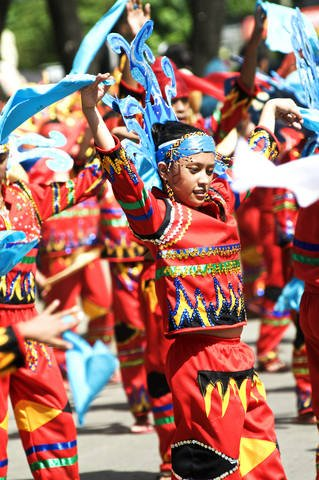 Traditional dance performed at street parade during Kadayawan Festival.