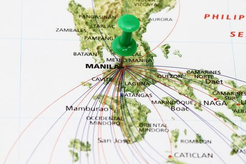 Travel to Manila showing flights arriving from various locations.