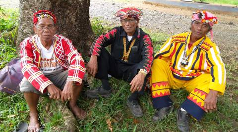 Three tribal elders or Datus sitting under a tree in Malaybalay City, Philippines.